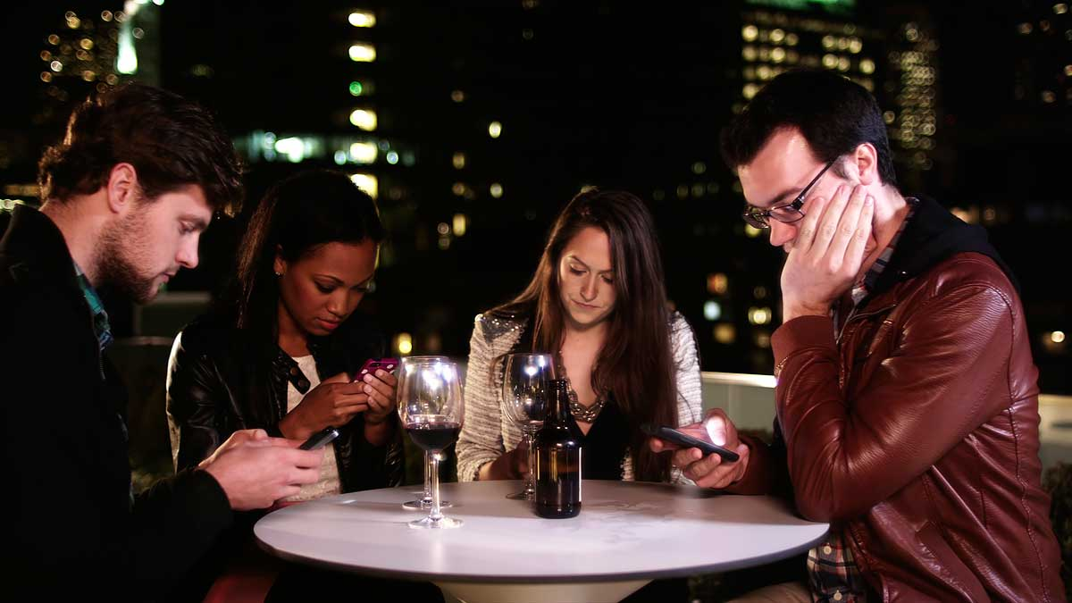 four-people-at-the-table-with-phones.jpg